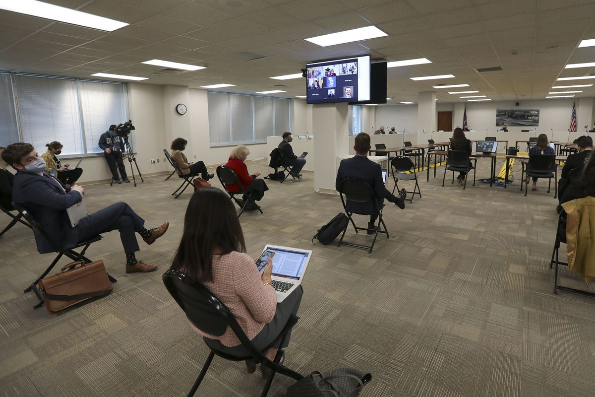 People attend a hearing in person and virtually for HB302 before the House Education Committee at the State Office Building in Salt Lake City on Thursday, Feb. 11, 2021.The bill would bar transgender athletes at public schools to participate in girls sports.