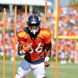 Broncos rookie RB David Williams makes a cut through the poles.