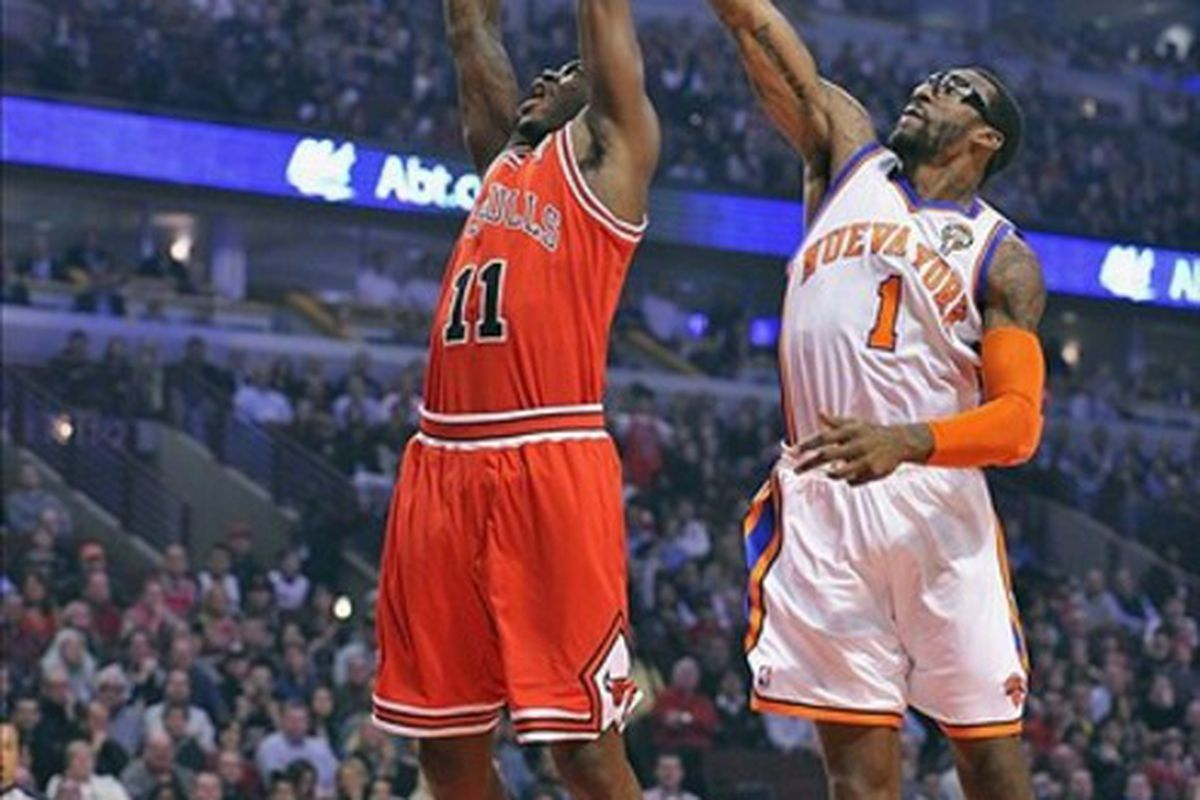 Mar 12, 2012; Chicago, IL, USA; Chicago Bulls shooting guard Ronnie Brewer (11) shoots the ball over New York Knicks power forward Amare Stoudemire (1) during the first half at the United Center.  Mandatory Credit: Mike DiNovo-US PRESSWIRE