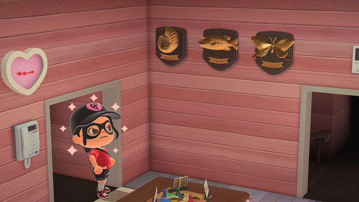 An Animal Crossing character proudly displays plaques with a fish, bug, and fossil on them