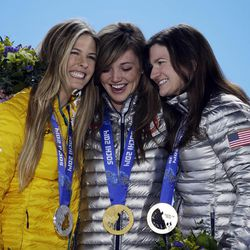 Women's snowboard halfpipe medalists, from left, Torah Bright of Australia, silver; Kaitlyn Farrington of the United States, gold; and Kelly Clark of the United States, bronze, pose with their medals at the 2014 Winter Olympics in Sochi, Russia, Thursday, Feb. 13, 2014. (AP Photo/Morry Gash)