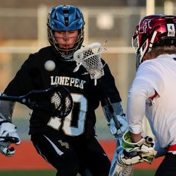 Lone Peak and American Fork compete in a boys lacrosse game in American Fork on Tuesday, March 30, 2021.