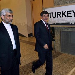 Turkey's Foreign Minister Ahmet Davutoglu, right, and Iran's Chief Nuclear Negotiator Saeed Jalili arrive for meeting in Istanbul, Turkey, Saturday, April 14, 2012. After years of failure, Iran and the six world powers may finally make some progress on nuclear negotiations when they meet again Saturday if each side shows willingness to offer concessions the other seeks.