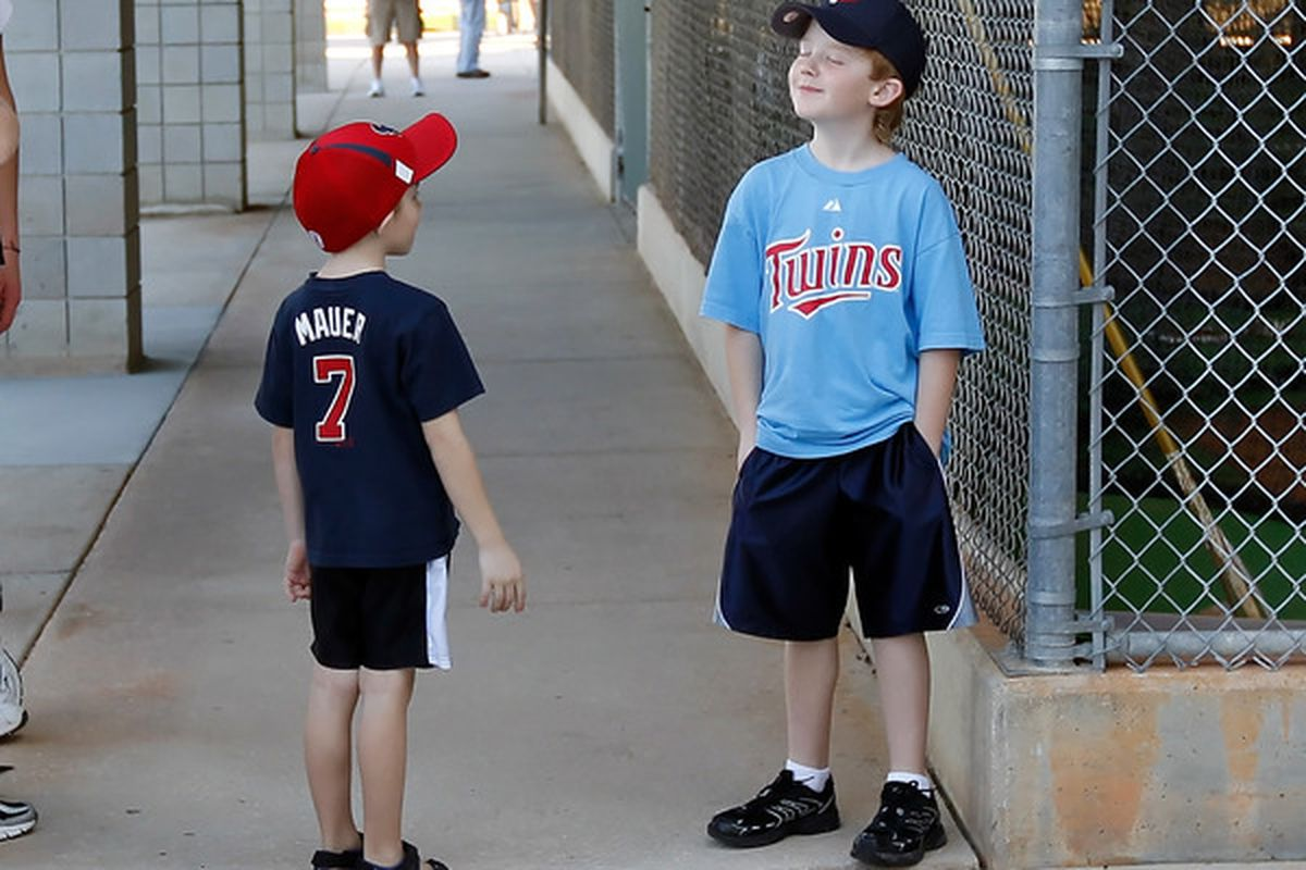 Justin Morneau, 7 years old, has not yet perfected his Canadian stoicism and cracks a smile as he refuses to let Joe Mauer, 5 years old, know where his mommy is.