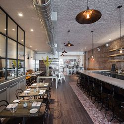 """<a href=""""http://ny.eater.com/archives/2014/04/racines.php"""">Racines, A French Wine Bar With a Michelin-Starred Chef</a>"""