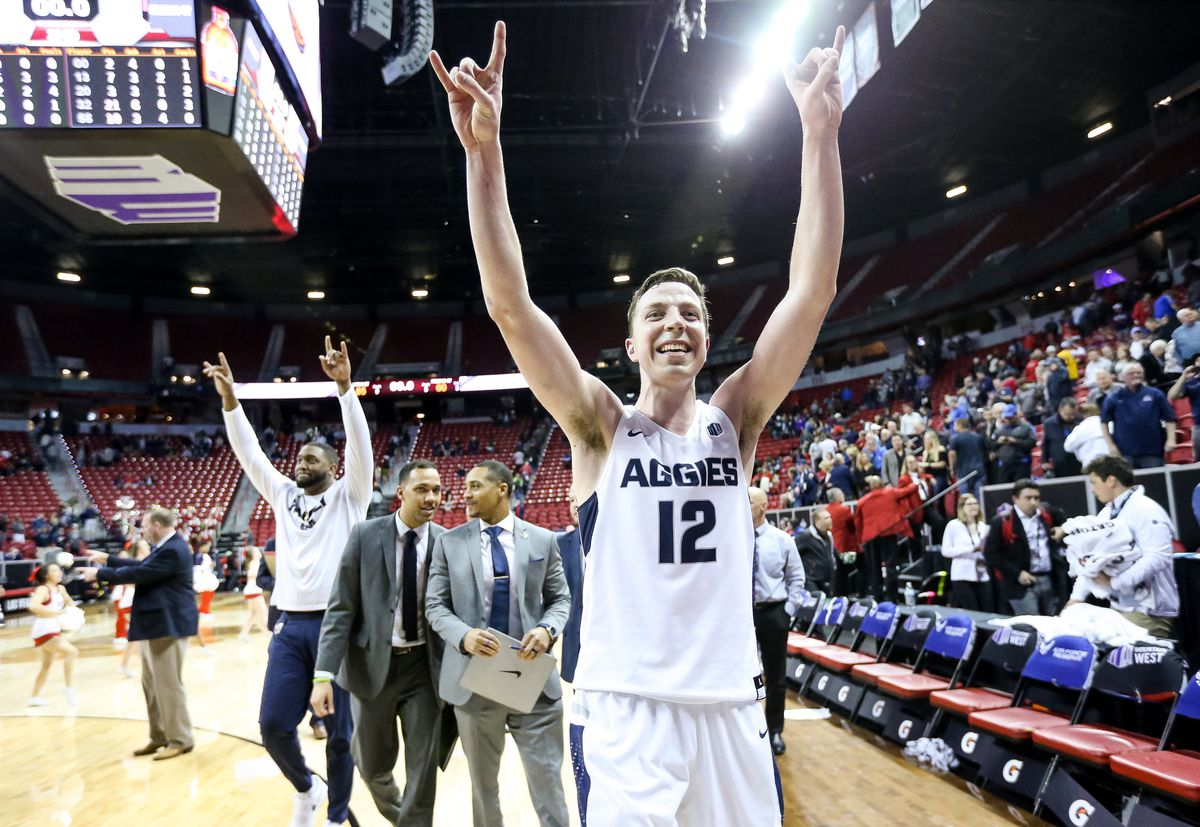USU forward Justin Bean walks off the court all smiles after a victory in the Mountain West Conference tournament in Las Vegas.