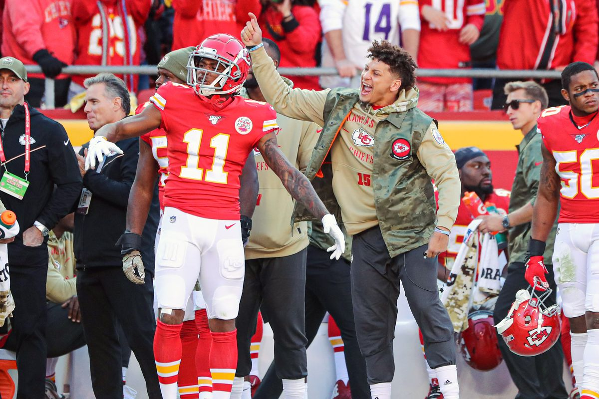 Kansas City Chiefs quarterback Patrick Mahomes and wide receiver Demarcus Robinson react to a play against the Minnesota Vikings during the second half at Arrowhead Stadium.