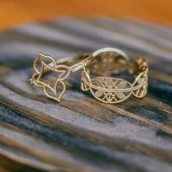 <b>Grace Lee</b> Lace Deco Ring V, $685 (left) and Lace Aztec Ring (right), $885
