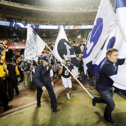 Brigham Young Cougars head coach Bronco Mendenhall and his players run onto the field as they and Missouri play at Arrowhead Stadium in Kansas City Missouri Saturday, Nov. 14, 2015.