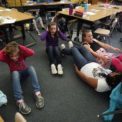 Students exercise in Nicole Carter's class at Tolman Elementary School in Bountiful, Monday, Nov. 26, 2012.