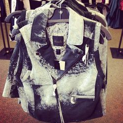 Chipped paint-like vests, $40. Balenciaga, eat your heart out.