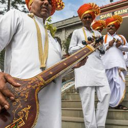 A procession of Warkari singers awaits Elder D. Todd Christofferson, a ember of the Quorum of Twelve Apostles for The Church of Jesus Christ of Latter-day Saints before escorting him to the Swami Vivekanand Mandap for an award ceremony at the MIT World Peace university in Pune, Maharashtra, India on August 14, 2017.