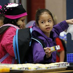 Guadalupe chooses her food during the Breakfast in the Classroom program at Backman Elementary School in Salt Lake City on Friday, Oct. 28, 2016.