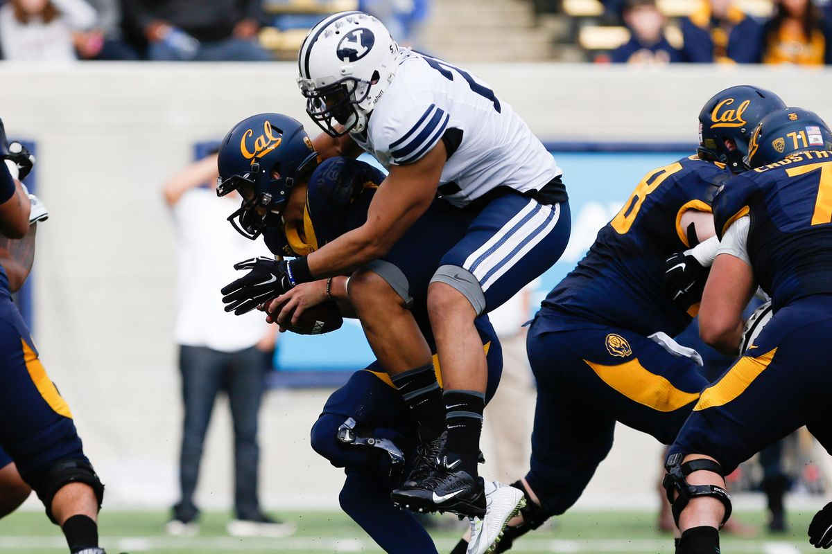 Harvey Langi attemps to sack the Cal quarterback in 2014