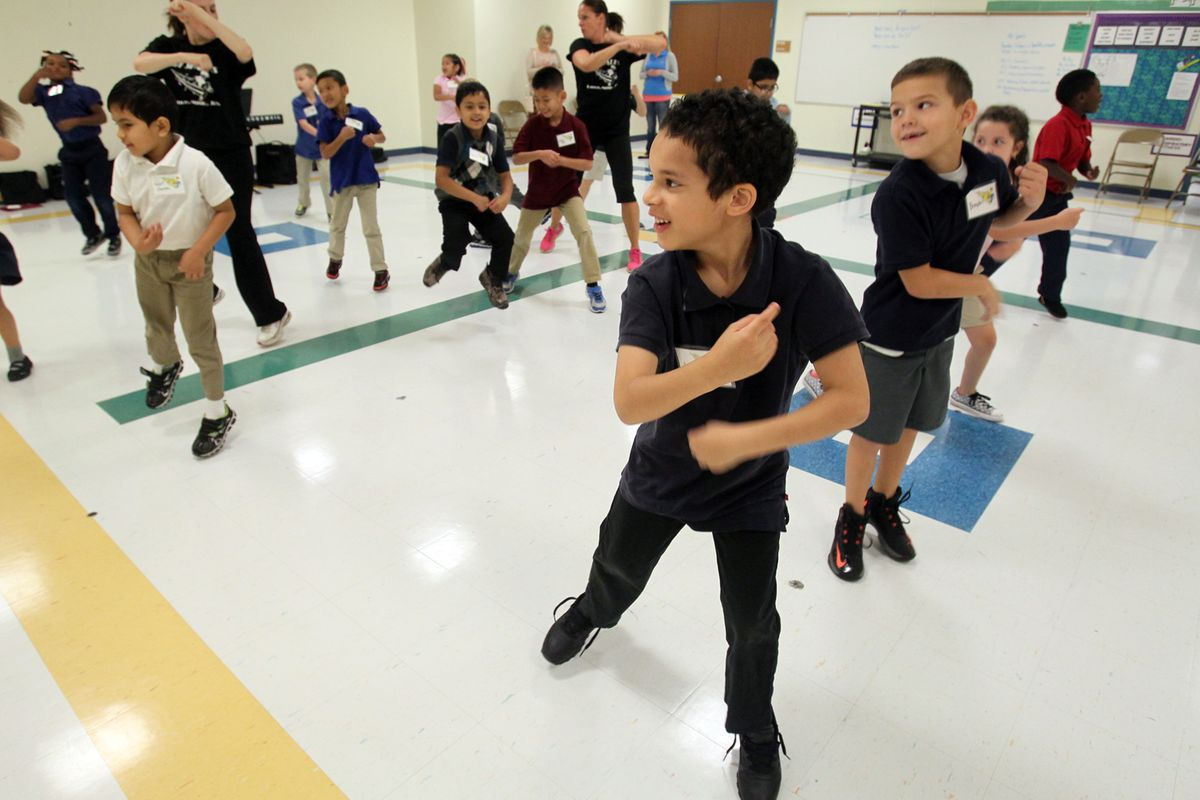 Third-grader Justin Willis, 7, center, dances with his classmates during an educational outreach program. (Mike Cardew/Akron Beacon Journal/TNS via Getty Images)