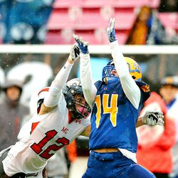 Mountain Crest's Cameron Moser (12) defends Orem's Trevor Rockey (14) on a long sideline pass as Orem and Mountain Crest play for the 4A football championship at Rice Eccles Stadium at The University of Utah in Salt Lake City on Friday, Nov. 17, 2017.