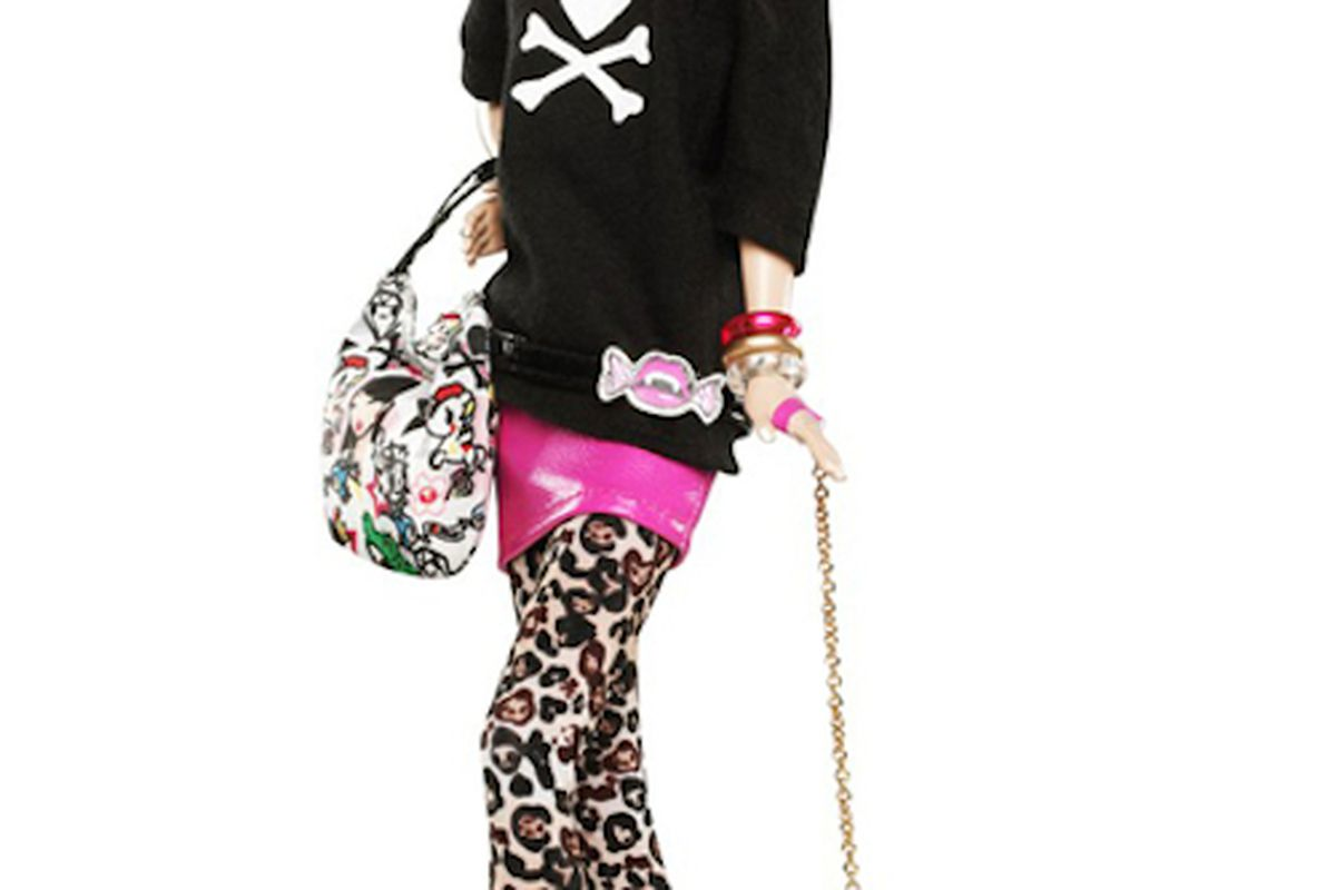 """She also comes with a keen sense of irony. Image via <a href=""""http://racked.com/archives/2011/10/18/new-tokidoki-barbie-has-pink-hair-and-tattoos.php"""">Racked</a>"""