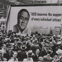 "USO billboard in front of Toffenetti via <a href=""http://www.ebay.com/itm/Crowd-billboard-President-Roosevelt-contributions-USO-Toffenetti-Restaurant-1941-/300746923741?pt=Art_Photo_Images&hash=item4605e9dedd#ht_1360wt_753"">eBay</a>."
