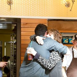A hug from Mom before the grand opening.