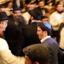 Rabbi Yisrolik Kievman, center, dances during a traditional Hasidic wedding at the Grand America Hotel in Salt Lake City on Monday, Sept. 12, 2016.