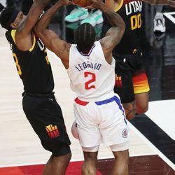 Utah Jazz forward Royce O'Neale (23) and Utah Jazz guard Jordan Clarkson (00)defend LA Clippers forward Kawhi Leonard (2) during the NBA playoffs in Salt Lake City on Thursday, June 10, 2021. The Jazz won 117-111.