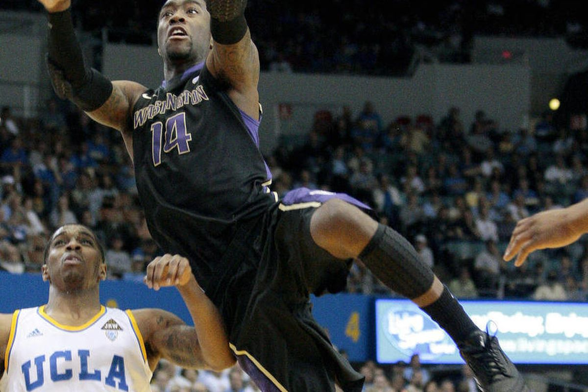 FILE - This March 3, 2012 file photo shows Washington guard Tony Wroten (14) driving to the basket as UCLA's Lazeric Jones (11) defends during the first half of an NCAA college basketball game,  in Los Angeles. Wroten has announced, Tuesday, April 3, 2012