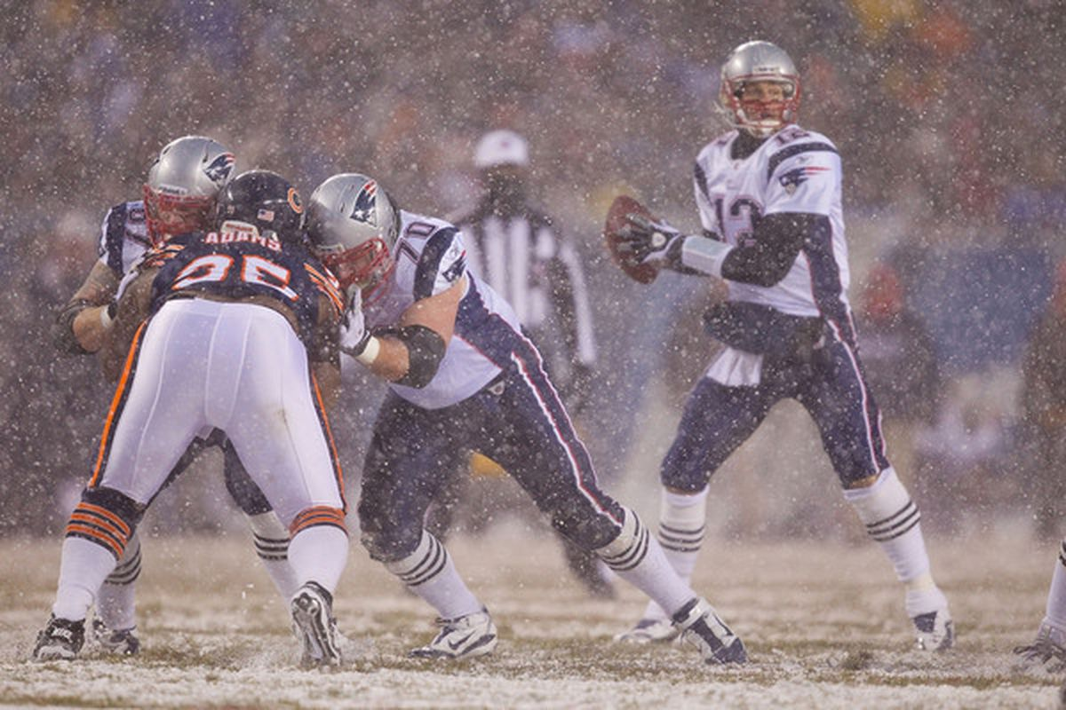 The New England Patriots battle the Chicago Bears in the snow. Now that's football weather (Photo by Dilip Vishwanat/Getty Images)