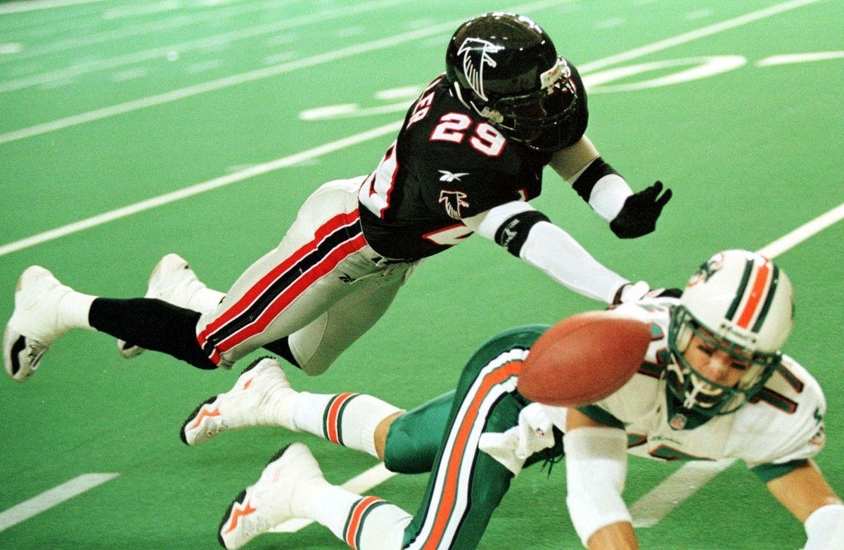 Atlanta Falcons' cornerback Randy Fuller(L) knocks