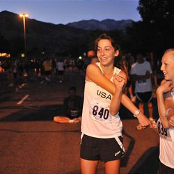MacKenzie Chojnacky and Mikesell Clegg stretch before running the Deseret News 10K race that started in Research Park and ended in Liberty Park in Salt Lake City Saturday.