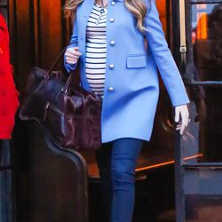 In a Gucci coat, Amour Vert top, J Brand jeans, and a Sandast bag on December 5th, 2014.
