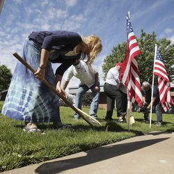 Stephen and Tammy Taylor break ground for the first Utah Gold Star Families Memorial monumentduring a ceremony in North Ogden on Tuesday, May 19, 2020. The Taylors' son,Maj. Brent Taylor of the Utah Army National Guard — and former mayor of North Ogden — was killed in Afghanistan on Nov. 3, 2018, during an insider attack that wounded another American soldier.