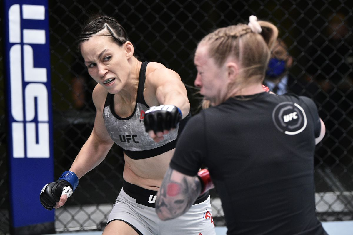 Jinh Yu Frey punches Kay Hansen in their strawweight fight during the UFC Fight Night event at UFC APEX on June 27, 2020 in Las Vegas, Nevada.