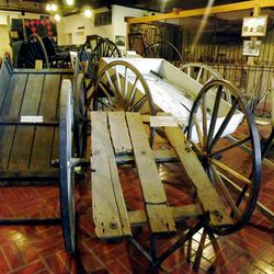 The Carriage House spotlights pioneer modes of transport, including handcarts from the mid-19th century.