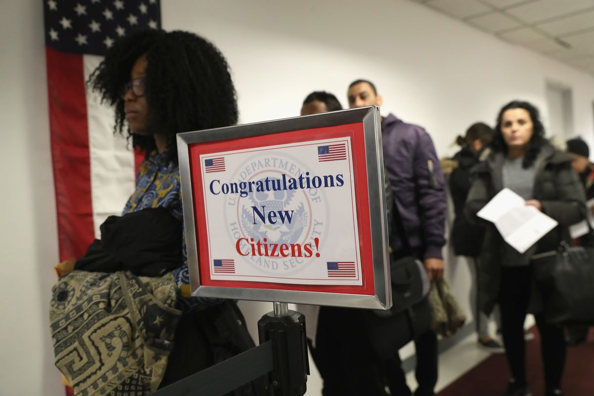 Family Members Congratulate New Citizens As President Trump's Immigration Policy Targets 'Chain Migration'
