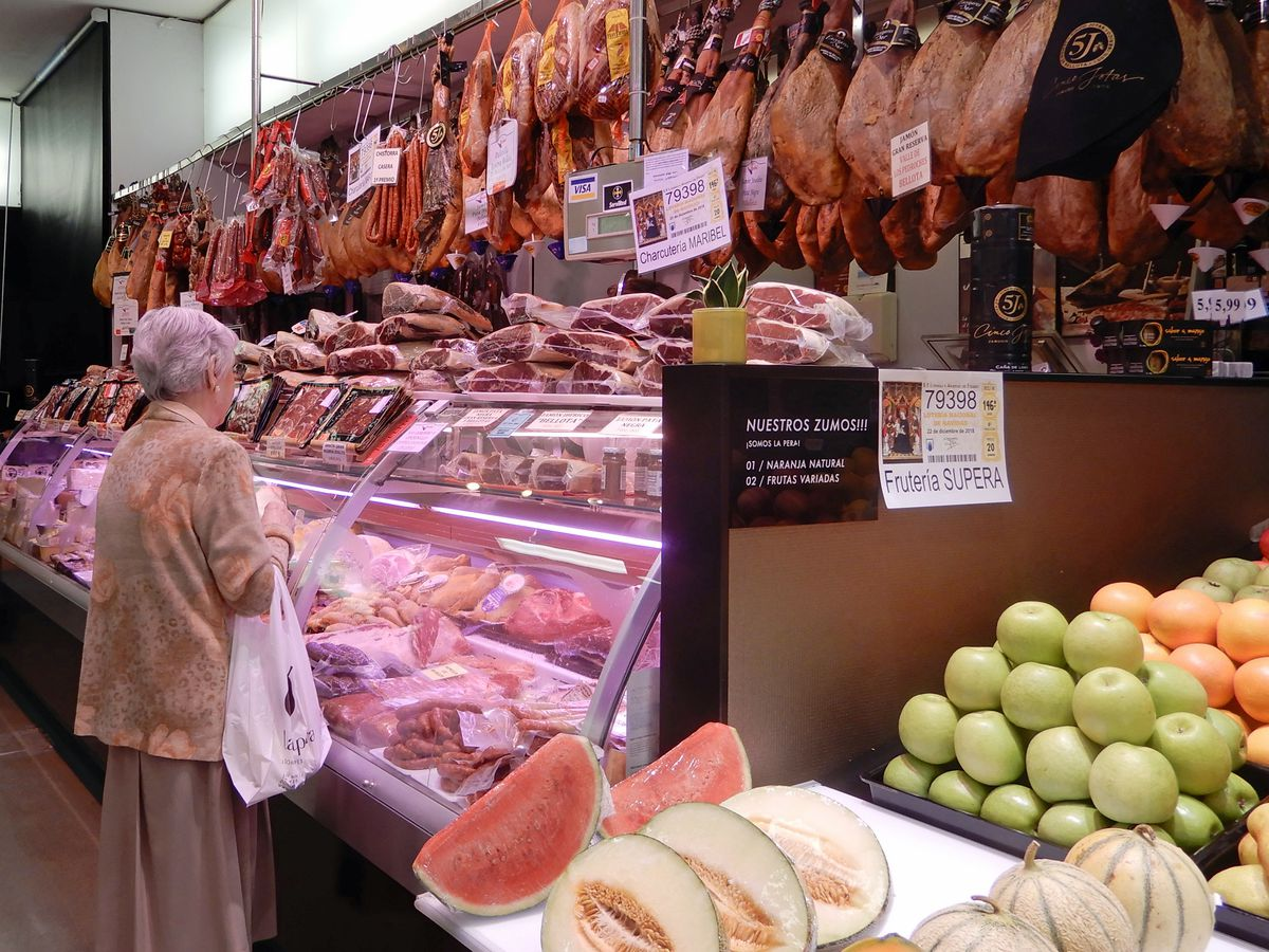 Woman Shopping for Charcuterie, San Sebastián, Spain
