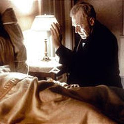 """Max von Sydow as Father Merrin and Linda Blair (under the covers) as 12-year-old Regan in """"The Exorcist."""""""