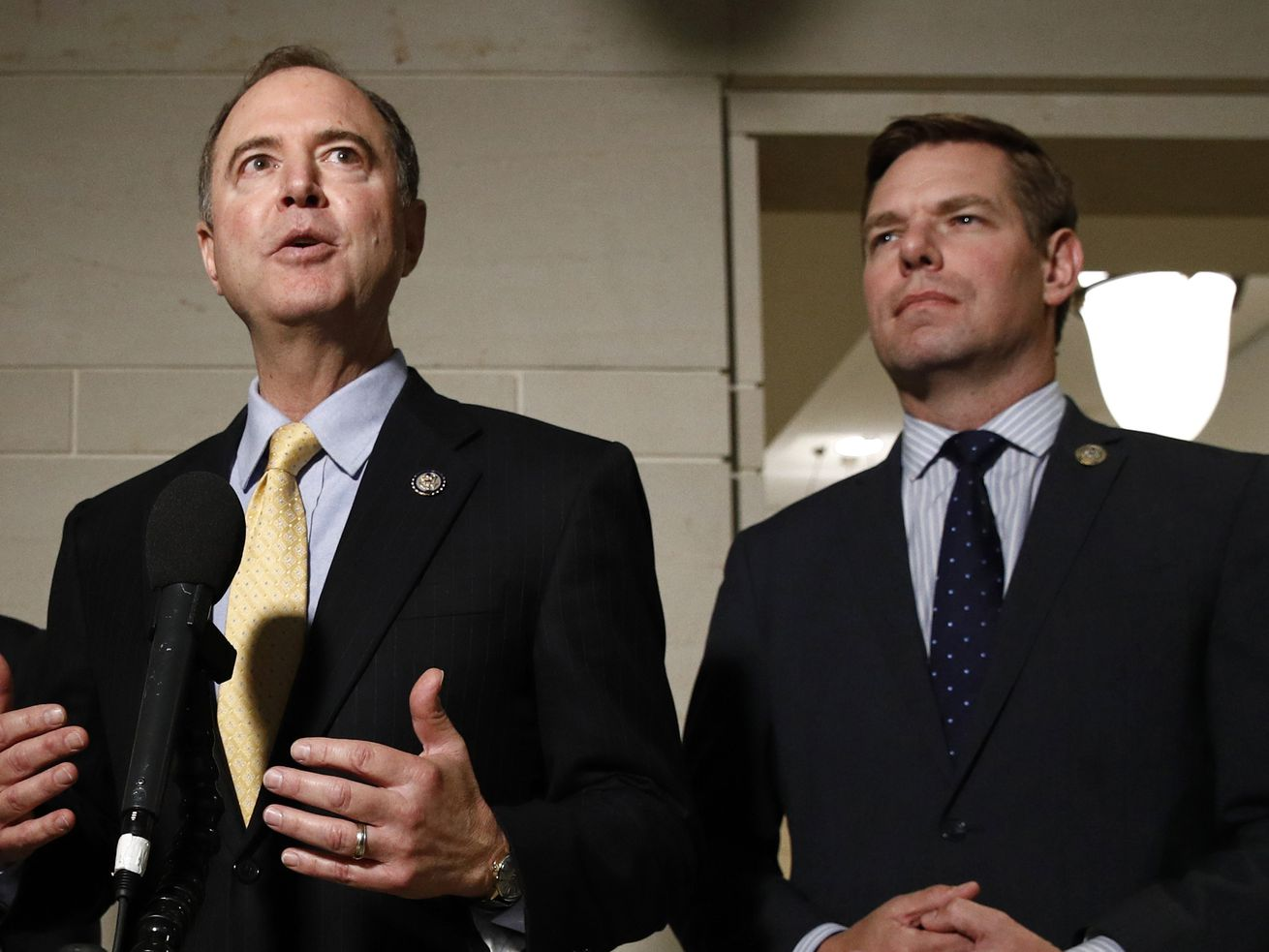 In this May 28, 2019 file photo, Rep. Adam Schiff, D-Calif., left, and Rep. Eric Swalwell, D-Calif., speak with members of the media on Capitol Hill in Washington.