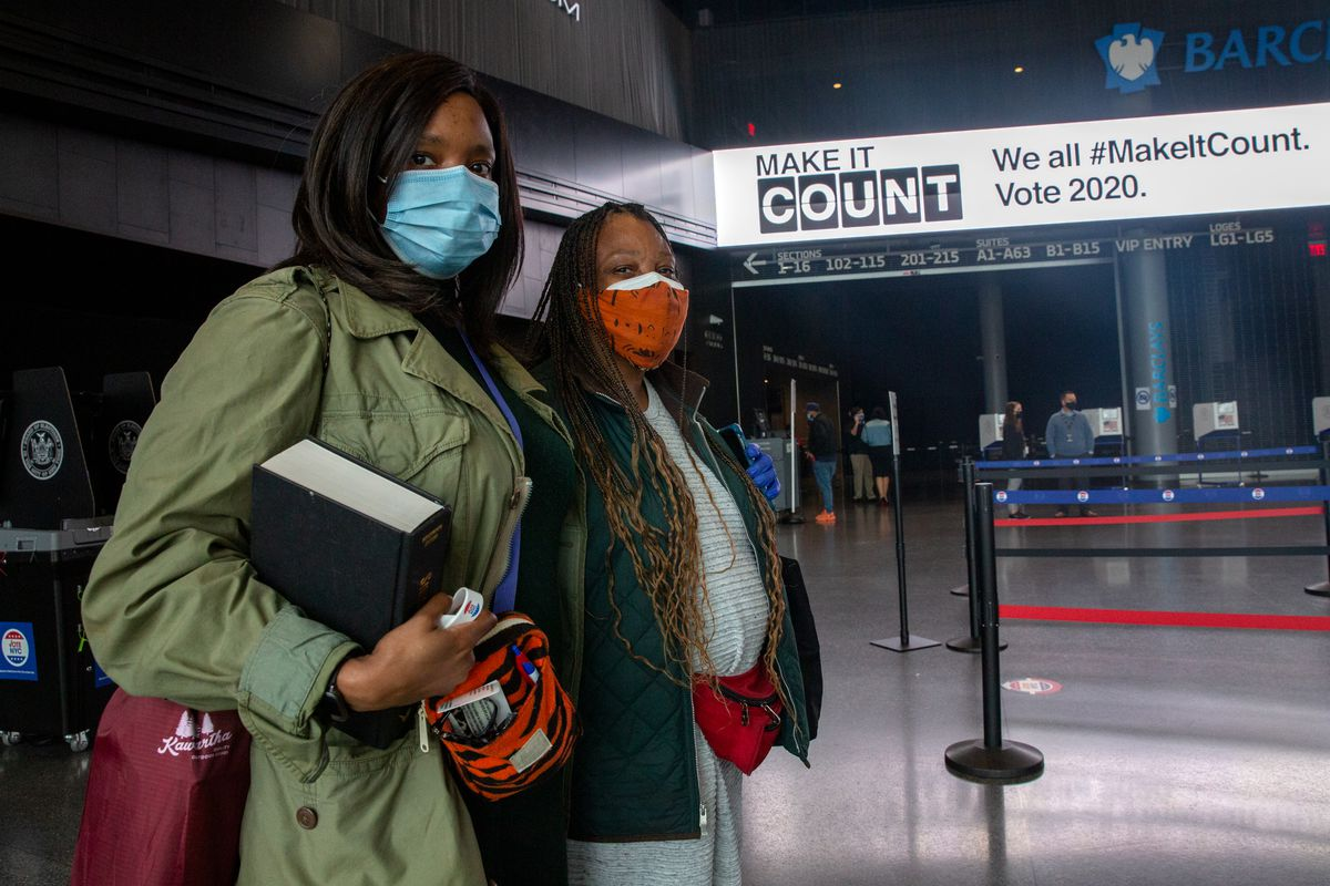 Mother and daughter Umi Shakti, left, and Norma Maupin, were second in line to vote at the Barclays Center early Saturday, Oct. 24, 2020.