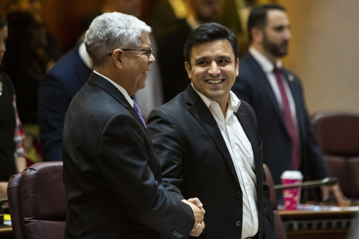 Ald. Byron Sigcho-Lopez (25th) (center), shakes hands with Ald. Roberto Maldonado (26th) before a City Council meeting in 2019.