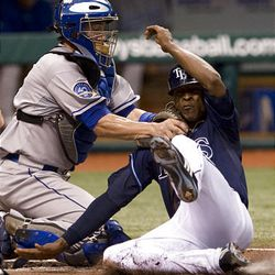 Kansas City Royals catcher John Buck, left, tags out Tampa Bay's B.J. Upton at home plate in a game on Sunday.