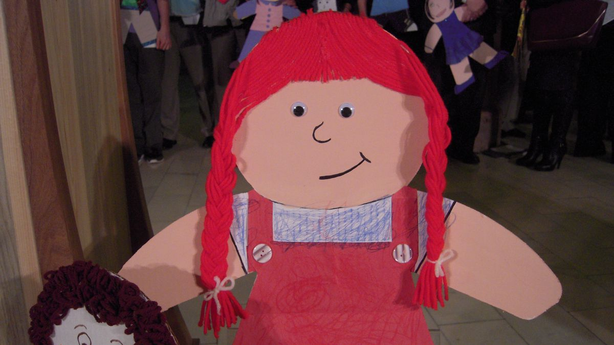 Homemade paper dolls greeted lawmakers Thursday, reminding them to focus on children.