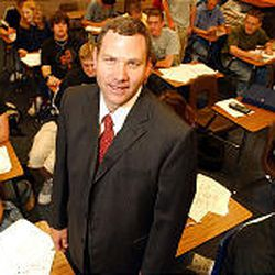Bingham High School teacher Scott Crump poses with one of his classes September 16, 2003 at Bingham High, Crump is the Jordan District Teacher of the year.