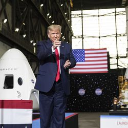 President Donald Trump points to Elon Musk as he arrives to speak after viewing the SpaceX flight to the International Space Station, at Kennedy Space Center, Saturday, May 30, 2020, in Cape Canaveral, Fla.