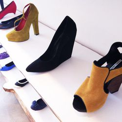 The structural sandal in the foreground comes in a handful of colors