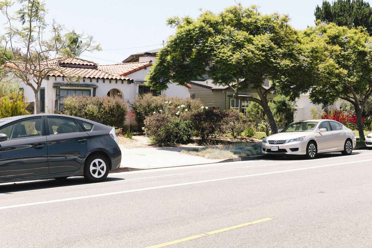 House with tree and car in front