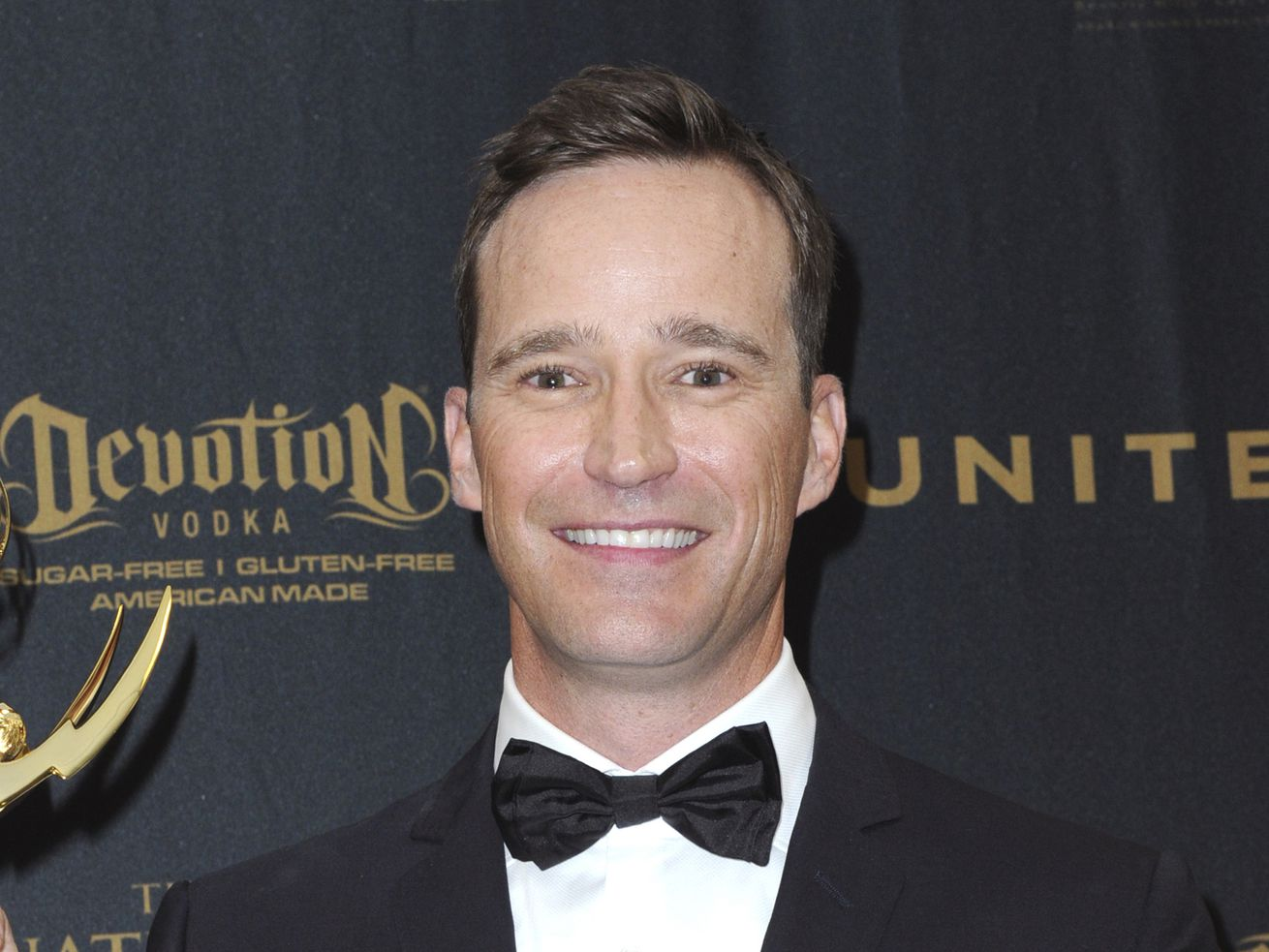 Mike Richards poses in the pressroom at the 43rd annual Daytime Emmy Awards on May 1, 2016, in Los Angeles.