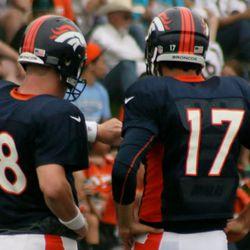 Denver Broncos quarterbacks Peyton Manning and Brock Osweiler talk over drills