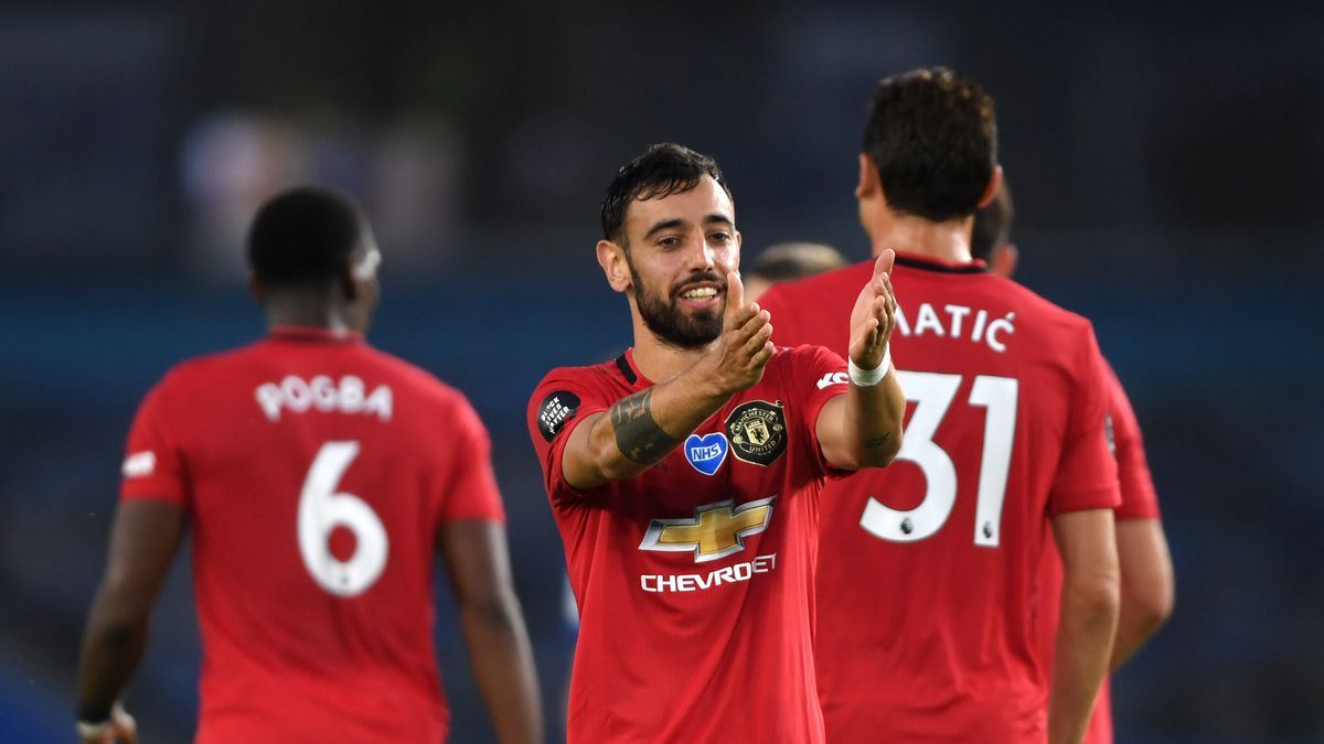 Bruno Fernandes of Manchester United scores his side's second goal at American Express Community Stadium on June 30.