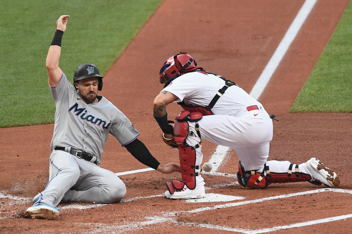 Adam Duvall #14 of the Miami Marlins slides into home base in the second inning against the St. Louis Cardinals at Busch Stadium