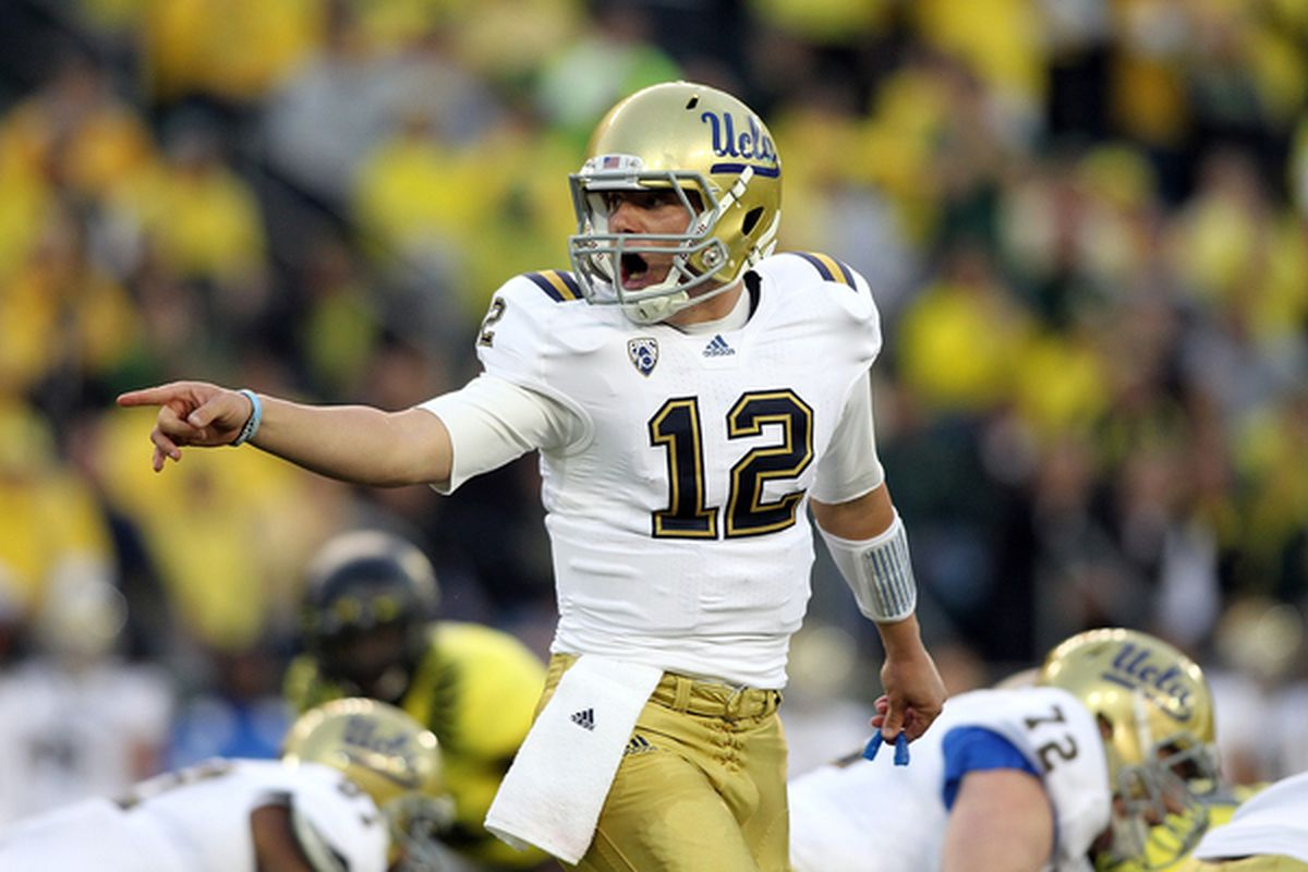 EUGENE OR - OCTOBER 21:  Richard Brehaut #12 of the UCLA Bruins  calls a play against the Oregon Ducks on October 21 2010 at the Autzen Stadium in Eugene Oregon.  (Photo by Jonathan Ferrey/Getty Images)